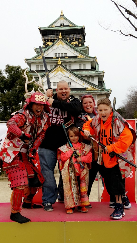 Pretending to be samurai's with your family in front of Osaka Castle in Osaka, Japan