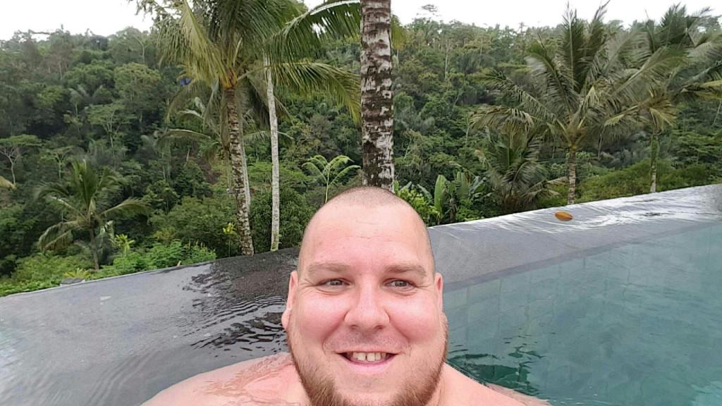 Taking a selfie in the 90 meter infinity pool at Padma Resort, in Ubud Bali